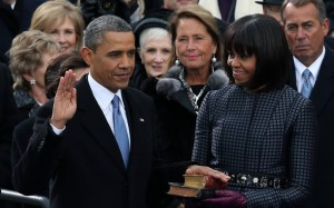 President Obama being sworn in for second term with wife Michelle Obama holding bibles of Lincoln and King