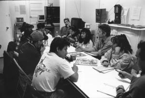 Director David Riker, third from right, working with garment workers to develop La Ciudad
