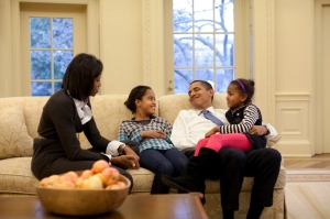 President Barack Obama relaxes on a sofa in the Oval Office with wife Michelle and daughters Malia and Sasha, Feb. 2, 2009. (Official White House Photo by Pete Souza) This official White House photograph is being made available for publication by news organizations and/or for personal use printing by the subject(s) of the photograph. The photograph may not be used in materials, advertisements, products, or promotions that in any way suggest approval or endorsement of the President, the First Family, or the White House.